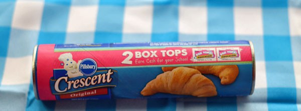 A can of original pillsbury crescent rolls on a blue and white checkered background