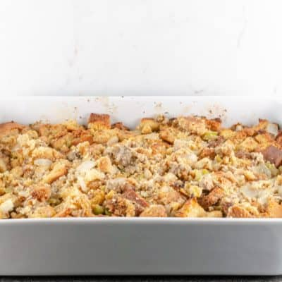 Cornbread and Sausage Dressing Recipe baked in a white casserole dish and ready to serve