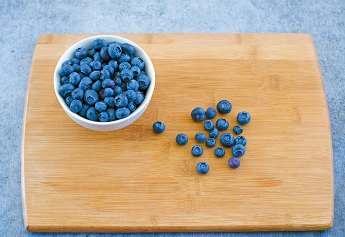 Blueberries on cutting board and in bowl