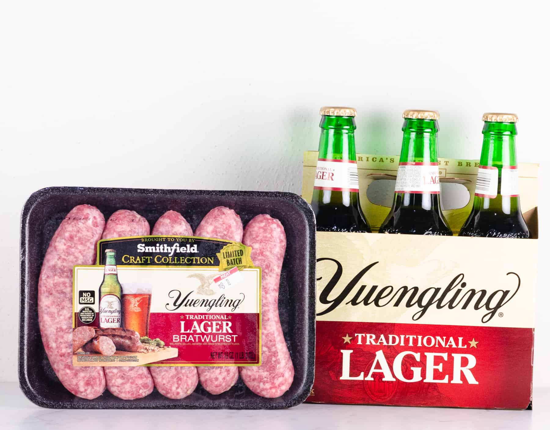 Raw Yuengling Lager Bratwurst with a 6-pack of Yuengling traditional lager