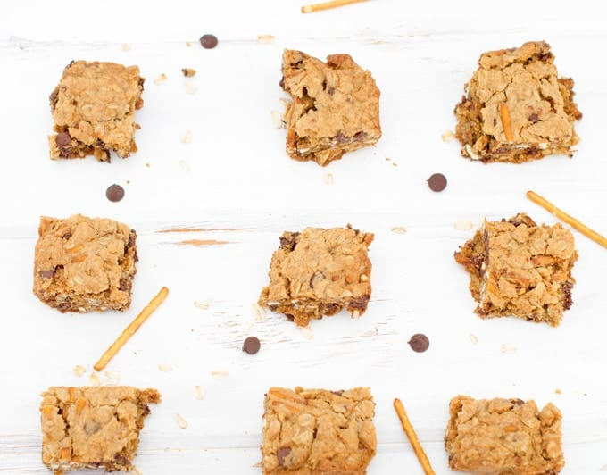 oatmeal chocolate chip pretzel bars cut up ready to eat on wood table