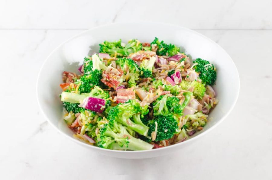 broccoli salad with bacon and cheese ready to eat in white bowl