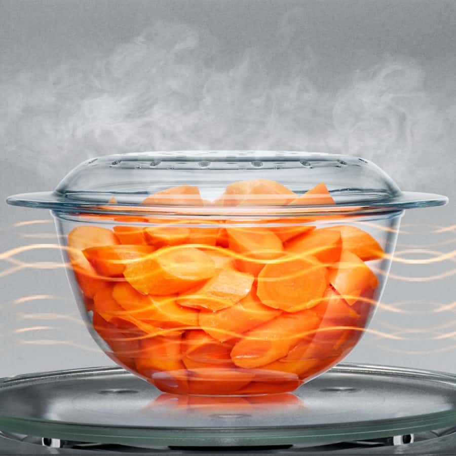 a photo of sliced carrots being cooked in the Breville Combi Wave 3-in-1 Microwave showing how it evenly cooks