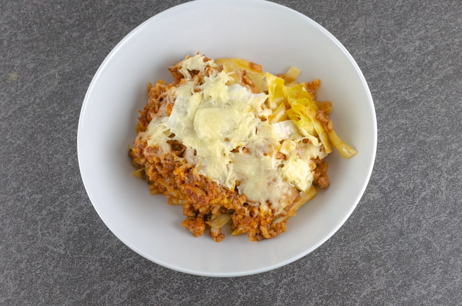 overhead shot of Creamy Unstuffed Cabbage Roll Casserole Recipe plated in a white bowl
