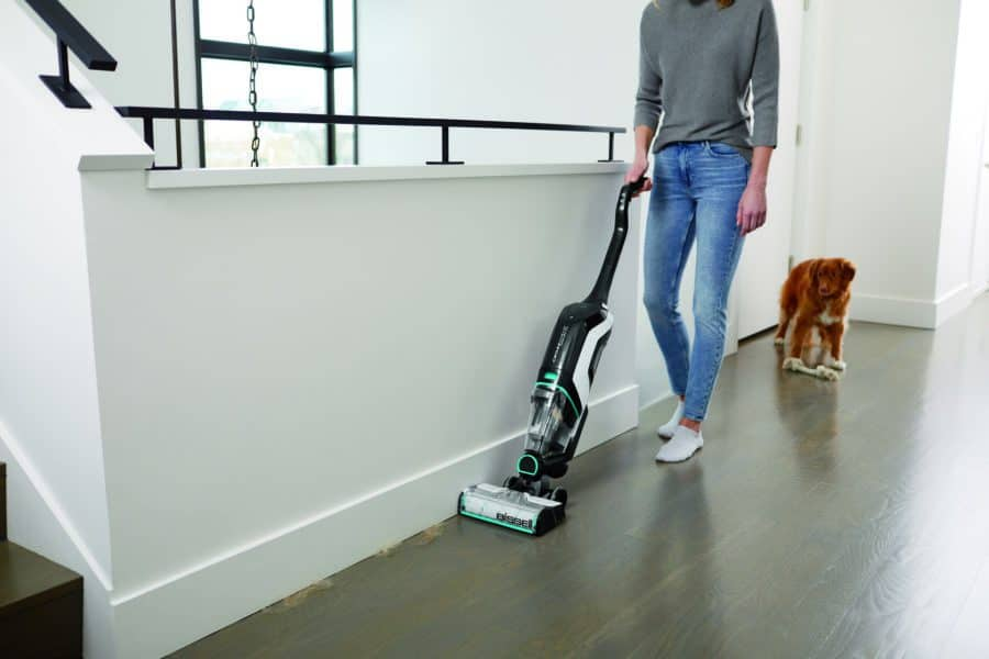 4 Reasons To Love The BISSELL CrossWave Cordless Max Multi-Surface Wet/Dry Vacuum - vacuum is picking up pet fur along the edge of a wall