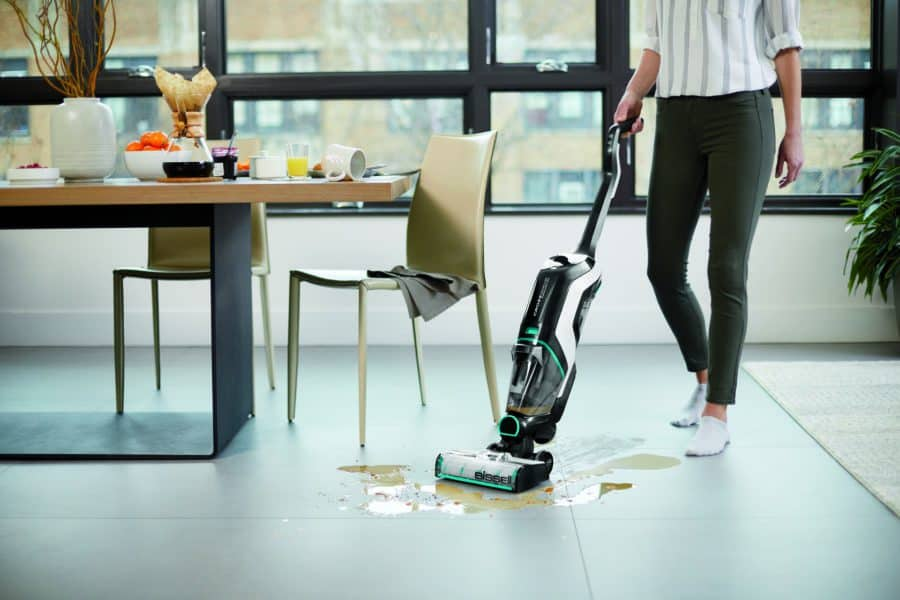 4 Reasons To Love The BISSELL CrossWave Cordless Max Multi-Surface Wet/Dry Vacuum - the vacuum is picking up a spilled drink
