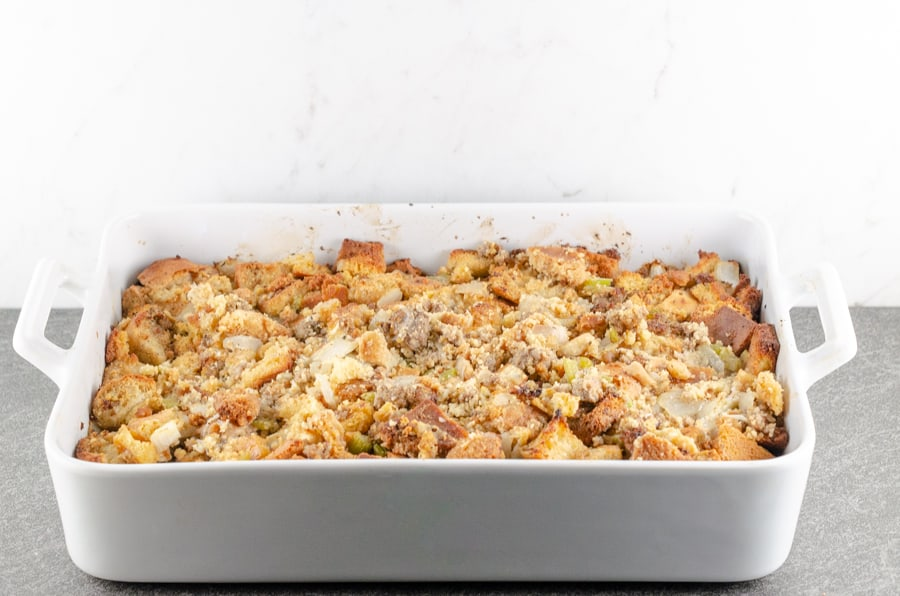 sausage cornbread dressing recipe photo shown freshly baked in a large white casserole dish