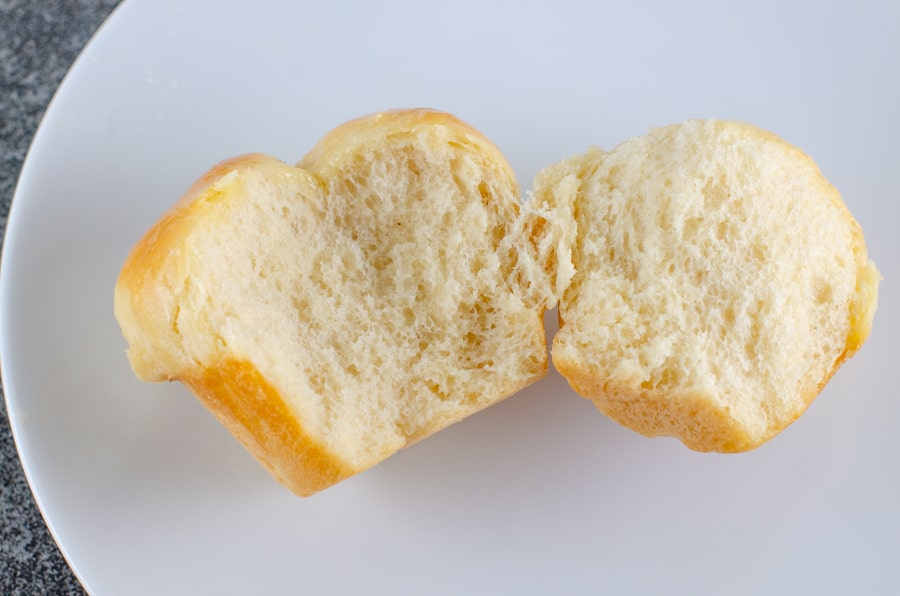 Homemade Cloverleaf Rolls Recipe with roll cut open showing the soft, white interior