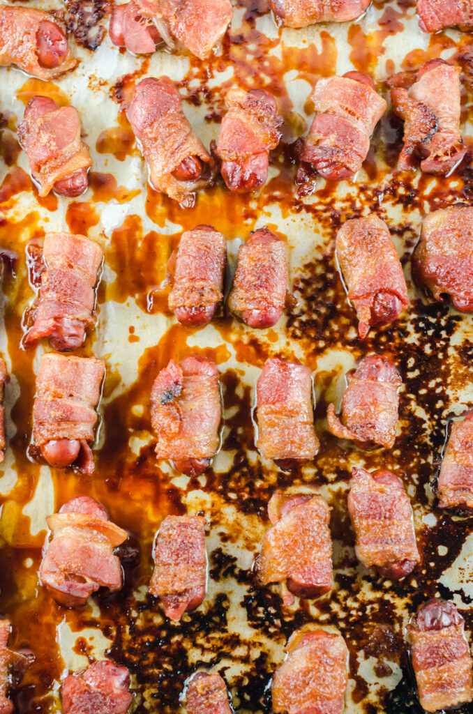 prepared bacon wrapped little smokies on the sheet pan